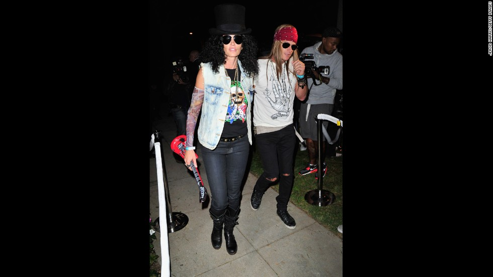Cindy Crawford, left, and Rande Gerber grooved at an October 25 Halloween party as  Slash and Axl Rose.