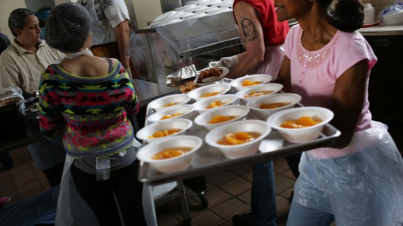 Volunteers prepare food at a soup kitchen run by Greater Waterbury Interfaith Ministries in May in Waterbury, Connecticut.