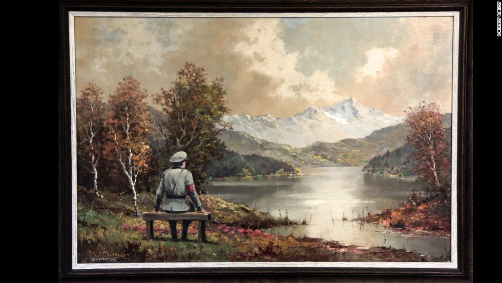 """The Banality of the Banality of Evil"" actually started out as a thrift store painting in New York City. Once altered by Banksy, who inserted an image of a Nazi officer sitting on a bench, it was re-donated to the store in October 2013, according to the<a href=""http://www.banksyny.com/"" target=""_blank""> artist's site</a>."