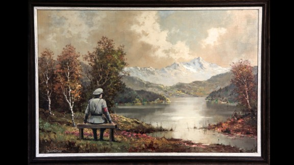 """The Banality of the Banality of Evil"" actually started out as a thrift store painting in New York City. Once altered by Banksy, who inserted an image of a Nazi officer sitting on a bench, it was re-donated to the store in October 2013, according to the artist's site."