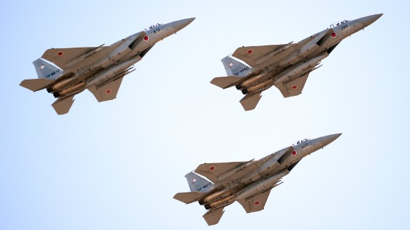 Japanese F-15 jets fly during a military review in 2013