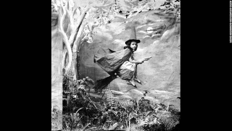 A  girl dressed as a witch hangs in midair on a broomstick. The images were originally produced in stereo. Two similar images were taken and when viewed through a special viewer, called a stereoscope, they produced a three-dimensional image.