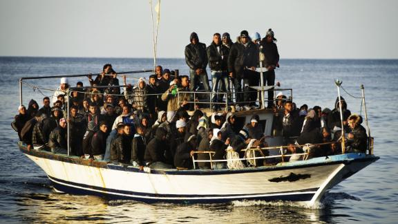 A boat full of immigrants is seen near the Italian island of Lampedusa on March 7, 2011.
