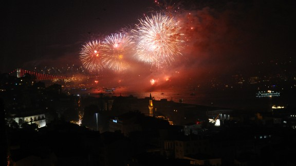 Fireworks explode above the Bosphorus Strait in Istanbul on Tuesday, October 29, during the anniversary of the declaration of the Turkish Republic. On Tuesday, Turkey formally opened the world's first sea tunnel connecting two continents. The Marmaray links Istanbul's European and Asian sides under the Bosphorus.