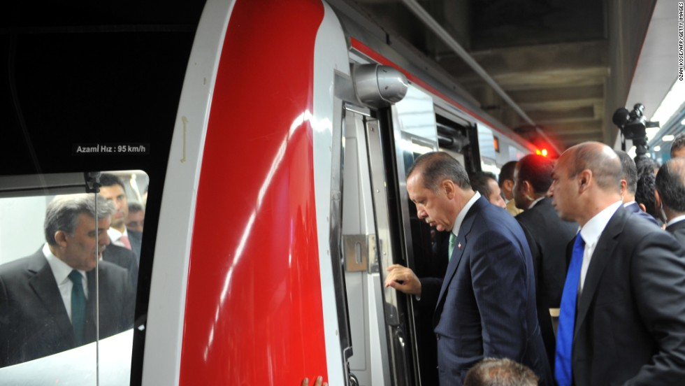 "Erdogan enters the train's cabin along with other dignitaries. Erdogan said the underwater railway ""connects history and future, past and the future, as well as connecting continents. Marmaray connects people, nations and countries."""