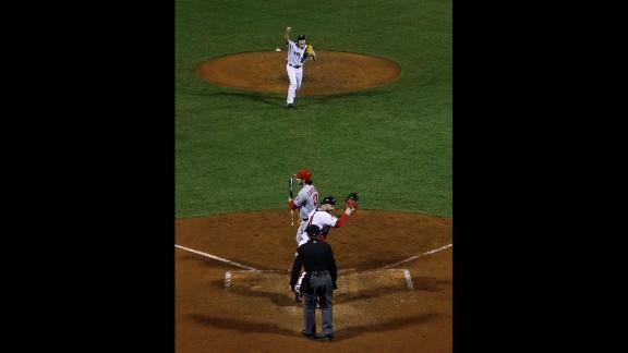 Red Sox relief pitcher Koji Uehara and catcher David Ross celebrate after striking out St. Louis Cardinals second baseman Matt Carpenter.