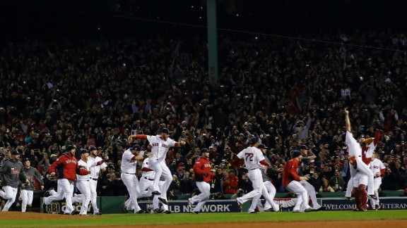The Red Sox take to the field in celebration.