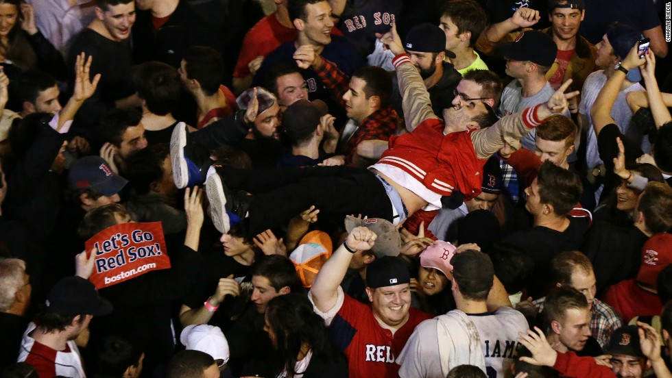 Fans celebrate after the Red Sox take the series.
