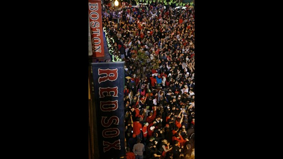 Boston Red Sox fans celebrate after the Cardinals' defeat.