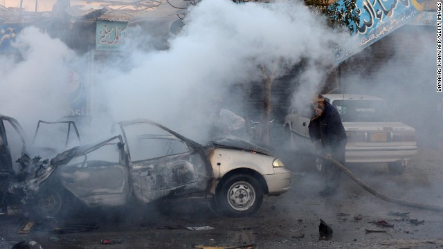 A Pakistani firefighter extinguishes burning vehicles after a bicycle bomb explosion in Quetta on October 30.