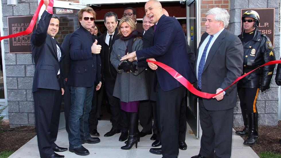 Booker helps cut the ribbon at the opening of affordable housing in Newark in December 2009. The housing was funded through Jon Bon Jovi's JBJ Soul Foundation. The musician is second from left.
