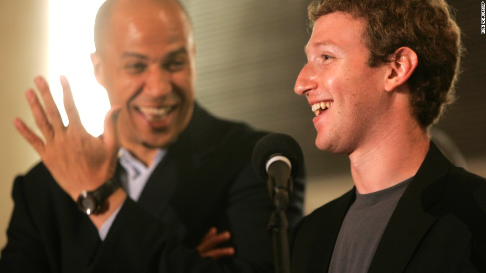 Booker laughs as Mark Zuckerberg, founder and CEO of Facebook, talks about his donation of $100 million to help Newark public schools during a news conference in September 2010.