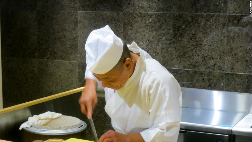 These days, this great man is running a 14 seat sushi bar in the Minato District of Tokyo. His wife, Naomi, is his only helper, Bourdain found.