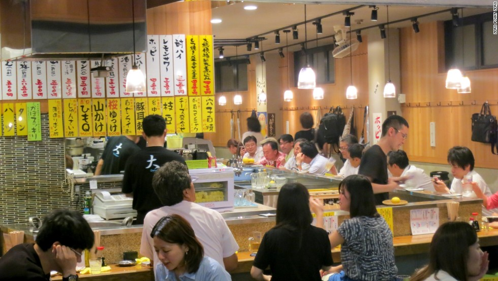 In the Taito Ward of Tokyo, excellent izakayas are well represented, places where a hard working salary man can have a beer or some sake or many beers and many sakes, says Bourdain.