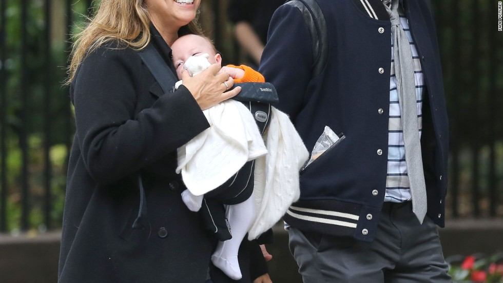 Jimmy Fallon and his wife step out with infant daughter Winnie.