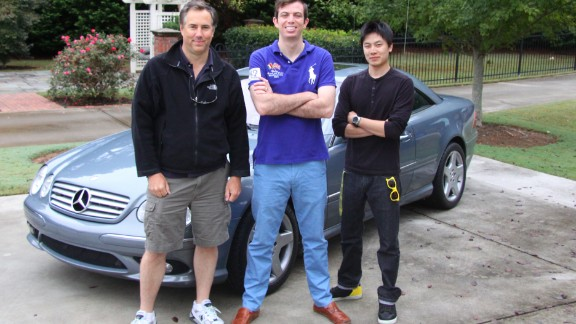 Dave Black, Ed Bolian and Dan Huang pose in front of the car they would use to attempt to break the record. Bolian is the leader and main driver, Black acted as the co-driver and Huang was the team