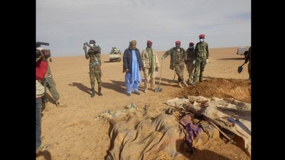 Volunteers dig graves for a group of migrants who died of thirst after their truck broke down in the Sahara Desert north of Arlit, Niger, on Wednesday, October 30.