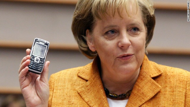 German Chancellor Angela Merkel holds her mobile phone during the plenary session of the European Parliament in Brussels, 27 June 2007.
