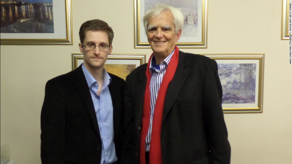 "National Security Agency leaker Edward Snowden poses with German Green party parliamentarian Hans-Christian Stroebele in Moscow on October 31. Stroebele returned from the meeting with a letter from Snowden to German authorities, which was distributed to the media. In it, Snowden said he is confident that with international support, the United States would abandon its efforts to ""treat dissent as defection"" and ""criminalize political speech with felony charges."""