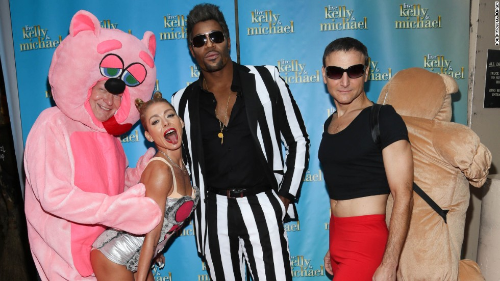 "Kelly Ripa, second from left, channeled a really good Miley Cyrus here with, from left, Art Moore, Michael Strahan and Michael Gelman at the ""LIVE With Kelly and Michael: Best Halloween Show Ever in New York."
