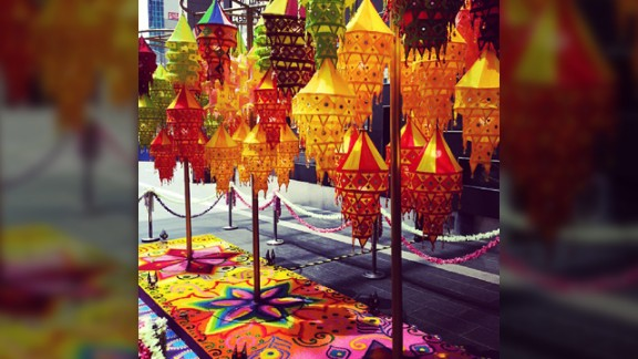 """The vibrant colors of the Diwali lanterns and a rangoli was captured by avid Instagrammer Vincent Paul JR a few days ago during his lunch break at a shopping mall in Kuala Lumpur, Malaysia. The 27-year-old, who teaches English at the local university, was raised as a Catholic but converted to Hinduism a few years ago. """"The lamps comply to the Hindu belief that light is a form of the divine. Rangoli is a symbol of welcome, Indians drew them on their doorsteps to invite all sorts good energy into their homes during special occasions. The rangoli is made out of edible colored rice which serves the purpose of feeding inferior beings such as rats, pigeons and ants as a form of good deed (Dharma) in the Hindu tradition,"""" he said."""
