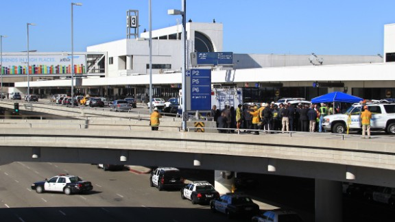 """Police officers and emergency response officials meet outside Terminal 3 at Los Angeles International Airport after <a href=""""http://www.cnn.com/2013/11/01/us/lax-gunfire/index.html"""">gunshots were reported</a> inside the terminal on November 1."""