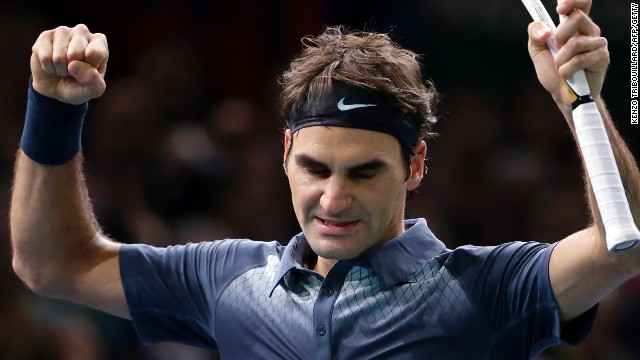 Roger Federer savors his moment of victory against Juan Martin Del Potro in the Paris Masters quarterfinals.
