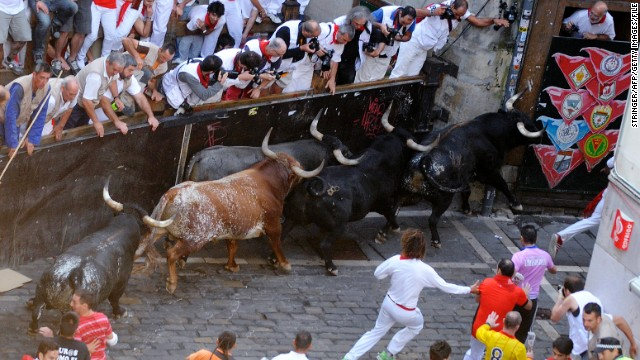 Fences separate the spectators from the bulls in Pamplona.
