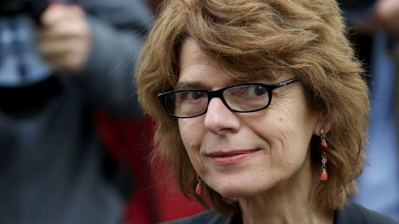 (Files) In this file picture taken on May 13, 2013 Vicky Pryce, ex-wife of former Biritish energy minister Chris Huhne poses outside her home in London following her release from prison. Britain's Queen Elizabeth II has removed a government honour awarded to the ex-wife of a former minister after the disgraced pair were jailed for swapping speeding points, officials said on Tuesday July 30, 2013. Huhne, 58, and his former spouse Vicky Pryce had been jailed in March for perverting the course of justice, after she took penalty points on her driving licence in 2003 so that her then husband could avoid a driving ban. Pryce, a Greek-born 60-year-old economist, revealed the points swap in 2011 in a bid to get revenge at Huhne after he left her for his publicist -- but the plan backfired and resulted in her being jailed herself. AFP PHOTO/ANDREW COWIEANDREW COWIE/AFP/Getty Images - S025059193