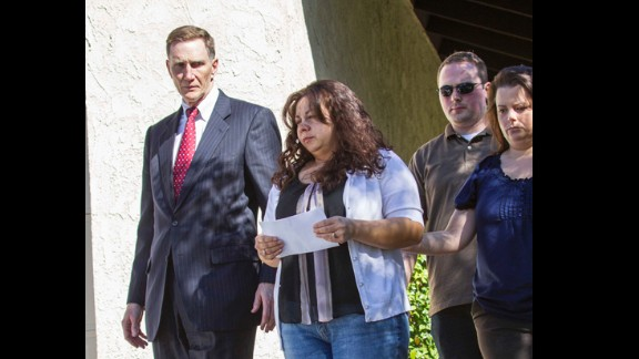 """TSA Administrator John S. Pistole, left, and Ana Hernandez, wife of slain TSA officer Gerardo Hernandez, prepare for a news conference in Porter Ranch, California on November 2. The slain officer """"was a wonderful husband, father, brother, son and friend,"""" his widow said."""