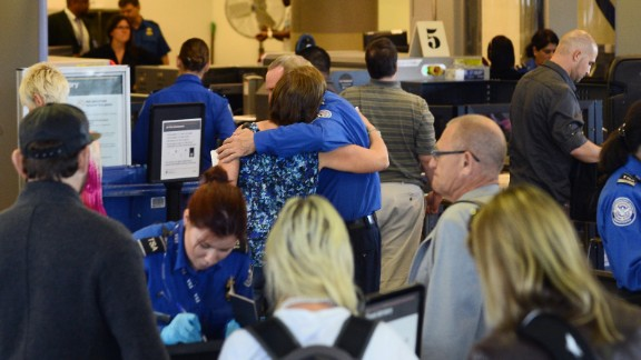 A passenger embraces a TSA screener at Los Angeles International Airport