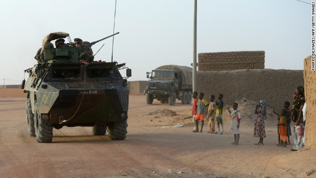 French troops have gone after militants in Mali, a former French colony. Here, a convoy passes civilians in northern Mali.