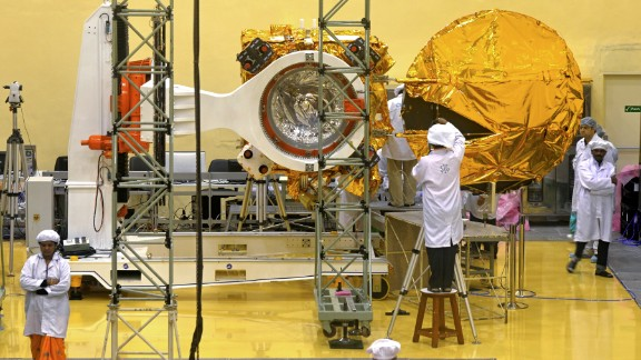 Scientists and engineers work on the Mars Orbiter vehicle at the Indian Space Research Organisation