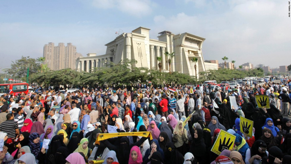 Supporters of deposed Egyptian President Mohamed Morsy protest his trial in front of the Supreme Constitutional Court in Cairo, Egypt, on November 4, 2013. Morsy, who was removed from office in a July 2013 coup, is charged with inciting violence over a constitution he shepherded into effect.