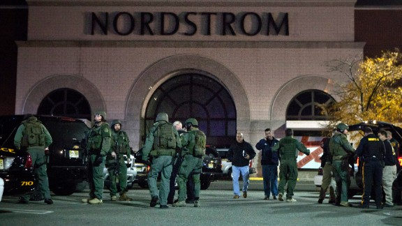 PARAMUS, NJ - NOVEMBER 04: Law enforcement officials gather outside of Garden State Plaza Mall following reports of a shooter November 04, 2013 in Paramus, New Jersey. According to reports, police are still searching for an alledged gunman that opened fire inside the mall. There has so far been no reports of injuries. (Photo by Kena Betancur/Getty Images)