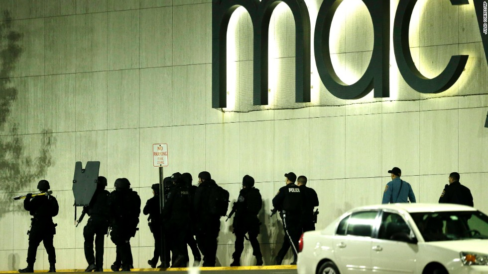 "SWAT police walk outside the Westfield Garden State Plaza on Monday, November 4, after a <a href=""http://www.cnn.com/2013/11/05/us/new-jersey-mall-shooting/index.html"">gunman opened fire</a> inside the mall in Paramus, New Jersey. Authorities said the gunman, Richard Shoop, fired at least six bullets inside the mall before holing himself up in a back room and shooting himself in the head. No one else was injured."