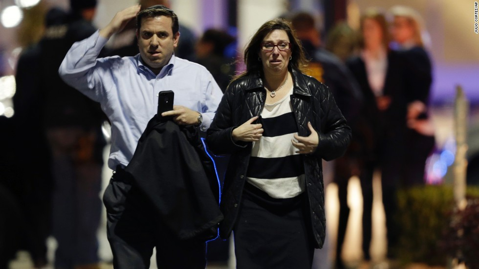 A man and woman leave the mall on Monday. The melee started around 9:20 p.m. ET, just as the mall was about to close.