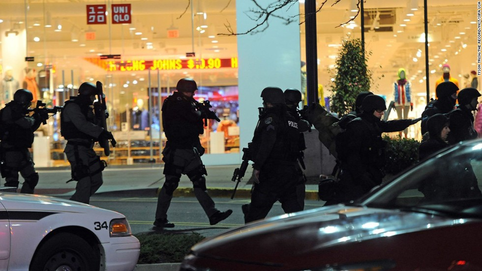 "Police move in formation at the mall. The reasons for the shooting remained unclear Tuesday, but Bergen County Prosecutor John Molinelli told CNN's ""New Day"" that Shoop's intent was either to commit suicide ""or to do something that would cause police to shoot him."""