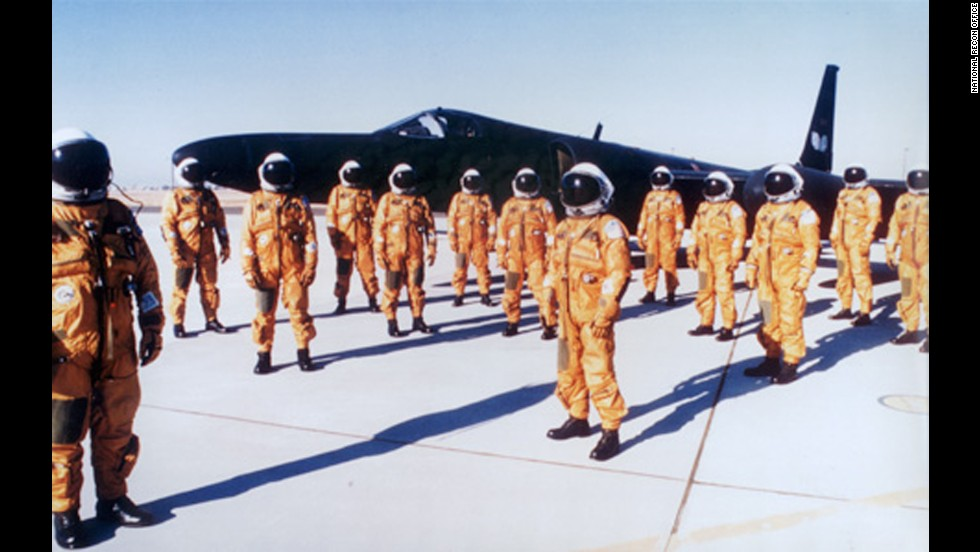 CIA pilots stand in pressure suits in front of a U-2 plane. The pilots needed the pressure suits for the extremely high altitudes.