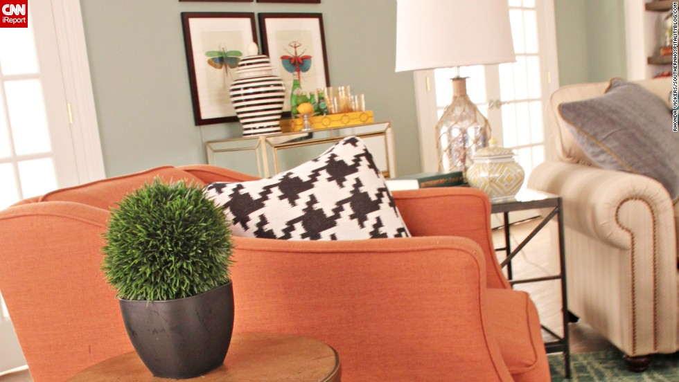 In Vickers' design, a bright pumpkin easy chair adds a warm touch to the room.