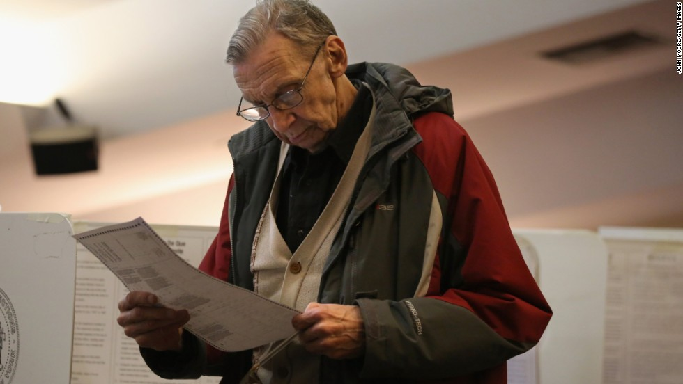 A voter studies his completed ballot at a polling station in Brooklyn.