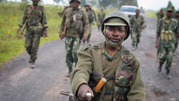 Congolese army soldiers march into Kibumba town in eastern Congo Monday, October 28.