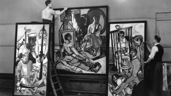 """German Expressionist painter Max Beckmann was among the artists pilloried by Adolf Hitler in the """"Degenerate Art"""" exhibition in Munich of 1937. Pictured here is his triptych 'Temptation' during a 1938 exhibition in London, which featured most of the artists ridiculed by Hitler."""
