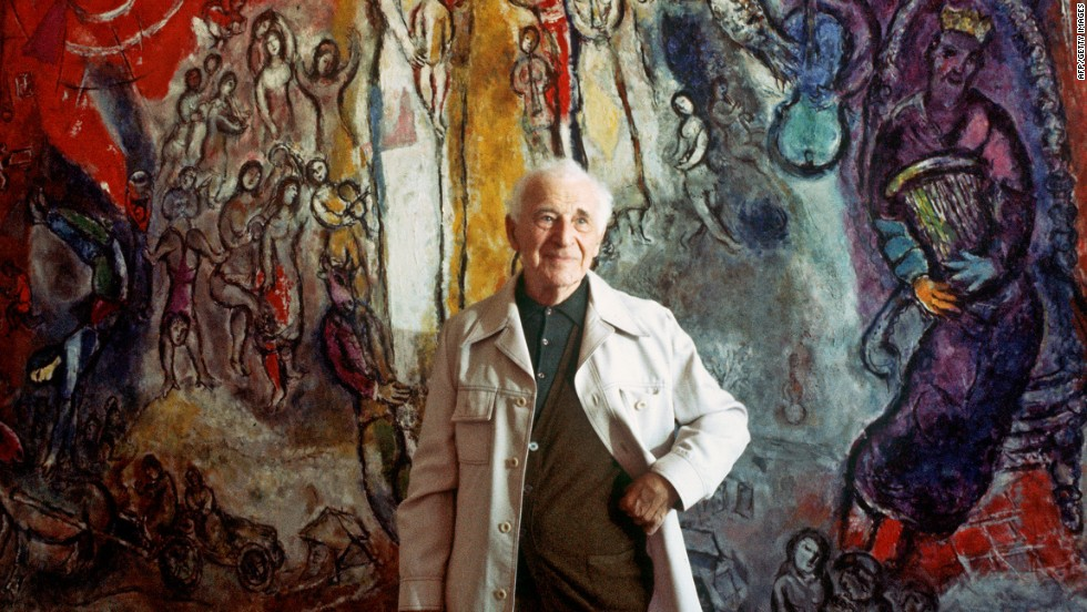 "Another ""degenerate artist,"" Marc Chagall, poses in front of one of his works in Nice, France, in 1977. A previously unknown piece by Chagall was among those found in a huge cache of artworks found in Munich in 2012."
