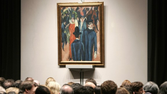 """Buyers look at Ernst Ludwig Kirchner's """"Berliner Strassenszene"""" (""""Berlin street scene"""") during a New York sale. Thousands of artworks condemned as """"degenerate"""" by the Nazis were confiscated in the 1930s and 1940s. The restitution of this painting prompted fears that Germany could lose countless pieces found to have been taken from their rightful owners."""
