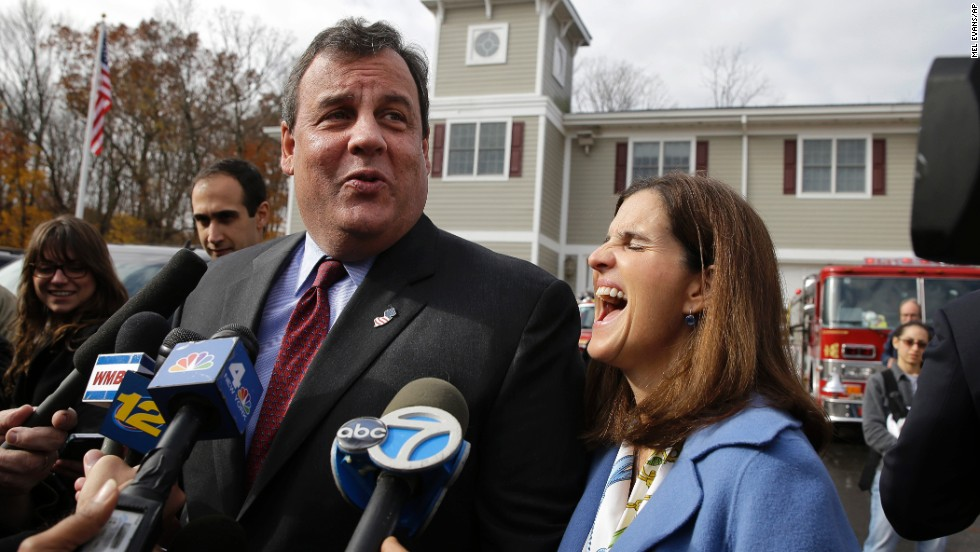 Christie and his wife, Mary Pat, joke with the media after voting.
