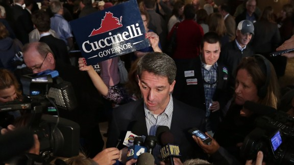 Cuccinelli answers questions from the media during a campaign stop the day before elections in Warrenton, Virginia.