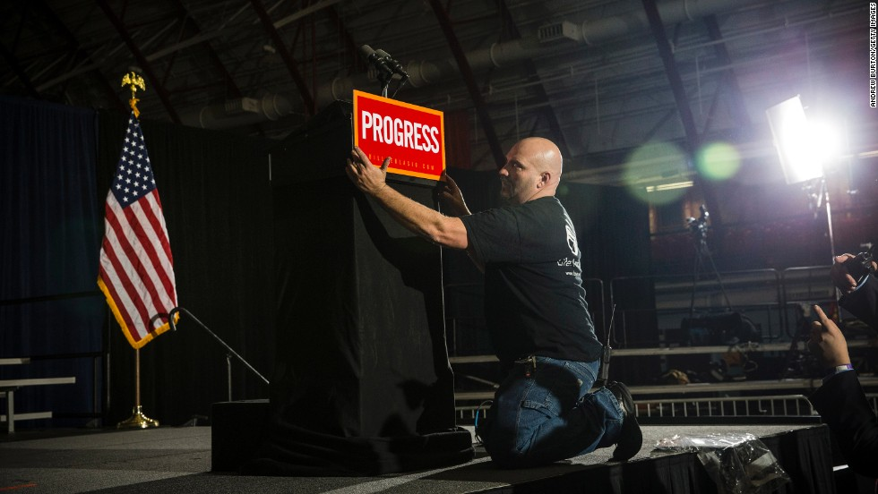 A man adjusts a sign on the podium prior to New York mayoral candidate Bill de Blasio's election night party on Tuesday, November 5. De Blasio defeated Republican candidate Joe Lhota to become the first Democratic mayor of New York City in more than two decades.