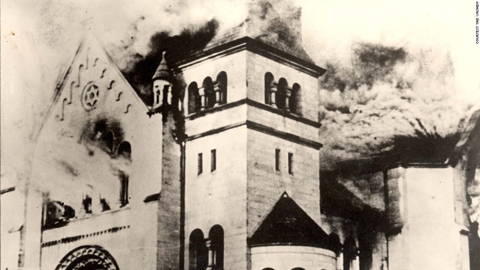 A synagogue burns in Baden-Baden, Germany.