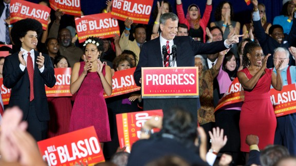 New York Mayor-elect Bill de Blasio celebrates his victory on Tuesday, November 5, with supporters and his children Dante, left, and Chiara, second left, and his wife, Chirlane McCray, right.